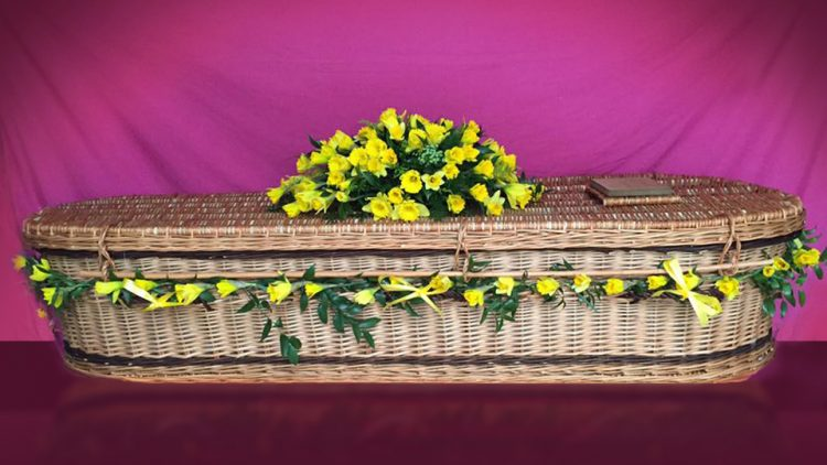 Weave Coffin – with flower arrangement